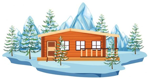Houten huisje in sneeuwveld