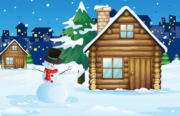 Houten hut op het sneeuwgebied