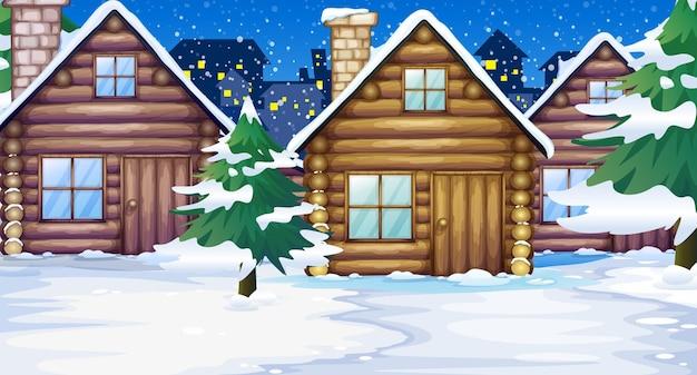 Houten hutten in de sneeuw