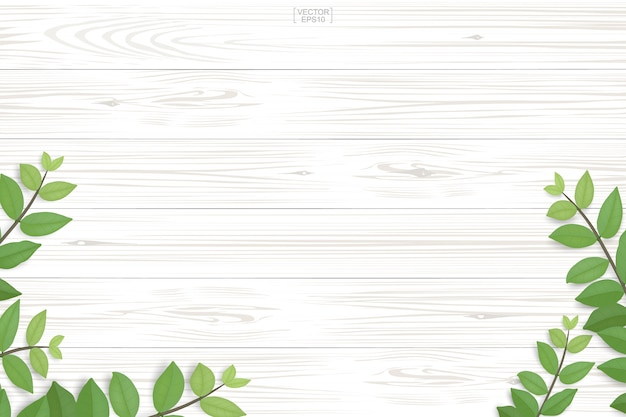Houten plankpatroon en textuur met groene bladeren voor natuurlijke achtergrond.