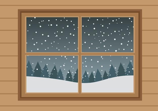 Houten ramen met witte vallende sneeuw