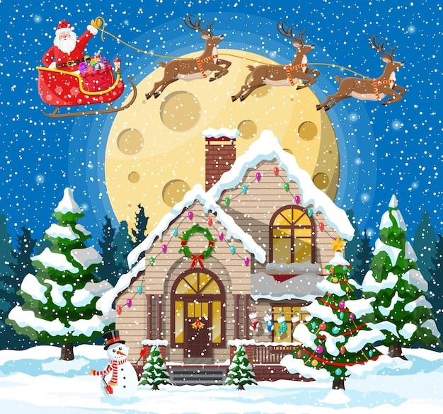 Huis bedekt sneeuw met kerstthema