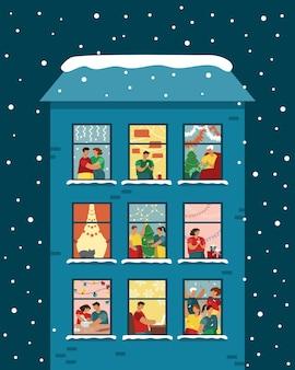 Huis met kerstramen, mensen vieren thuis het nieuwe jaar.