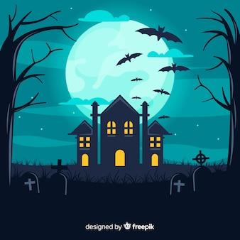 Huis op de achtergrond van begraafplaatshalloween