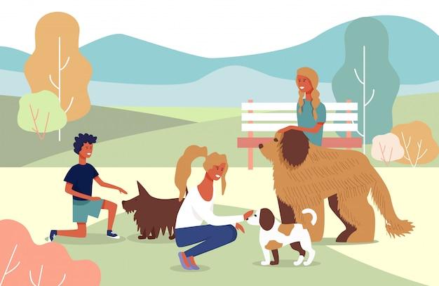 Huisdieren eigenaar familie op wandeling met honden in het stadspark