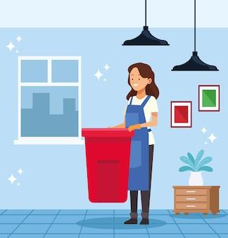 Huishoudelijke werkneemster met vuilnisafval