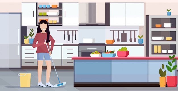Huisvrouw dweilen vloer vrouw schoner doen huishoudelijk werk meisje holding mop schoonmaak concept moderne keuken interieur volledige lengte vlak en horizontaal