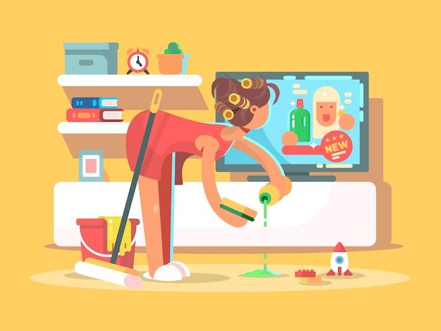 Huisvrouw maakt het huis schoon en kijkt tv