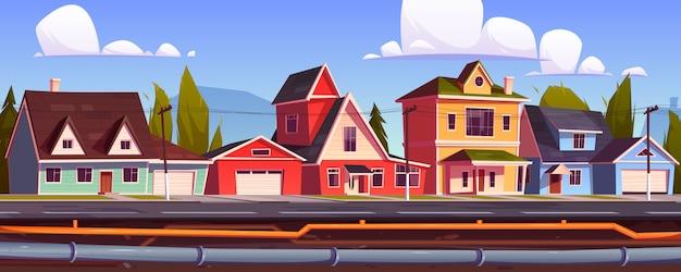 Huizen in de buitenwijken en ondergrondse pijpleiding. riool- en sanitairsysteem onder stadsstraat