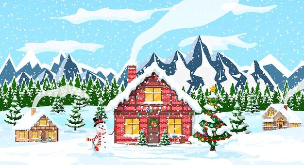 Huizen in de voorsteden bedekt sneeuw met bergen