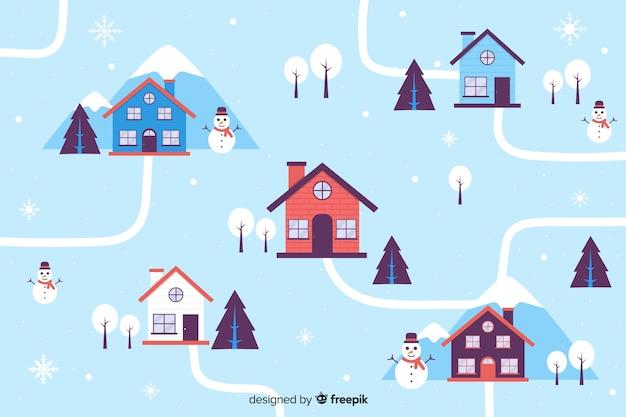 Huizen op kerstavond plat ontwerp