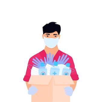Humanitaire hulp. levering van medische beschermingsmaskers en ontsmettingsmiddelen. corona-epidemie. bezorger die pakket levert