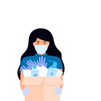 Humanitaire hulp. levering van medische beschermingsmaskers en ontsmettingsmiddelen. corona-epidemie. bezorgmeisje dat pakket levert.