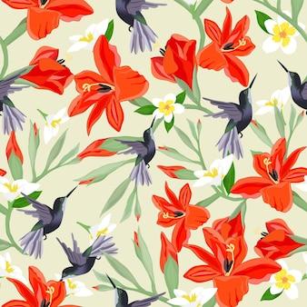 Humiingbird in oranje en wit bloesem naadloos patroon.