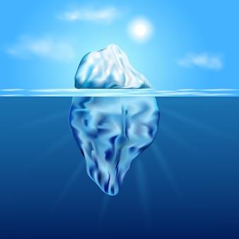 Ijsberg drijvend onder ijs. winter arctisch landschap met blauw zuiver water en sneeuwheuvels.