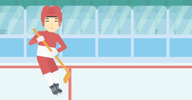 Ijshockeyspeler met stok vectorillustratie.