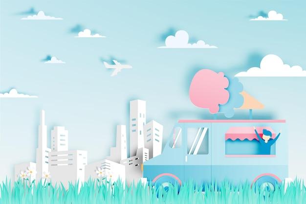 Ijsvoedselwagen in papierkunst met stad.