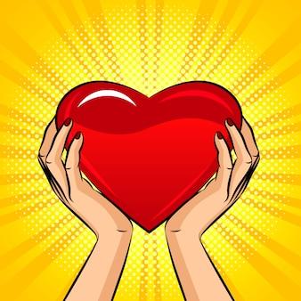 Illustratie in pop-art stijl, vrouwelijke handen houden een groot hart