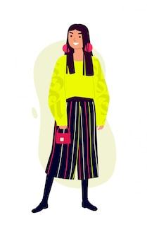 Illustratie van een modieus meisje in een felgele trui en gestreepte broek.