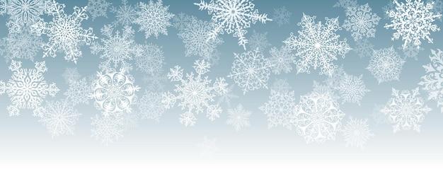 Illustratie van grote witte complexe kerstsneeuwvlokken op een grijze achtergrond