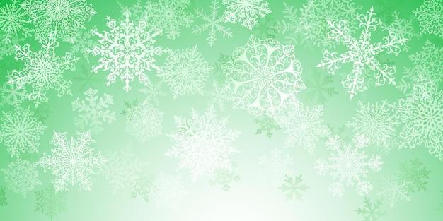 Illustratie van grote witte complexe kerstsneeuwvlokken op groene achtergrond