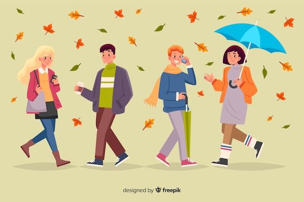 Illustratie van mensen die in de herfst lopen