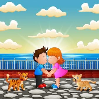 Illustratie van paar cartoon zoenen op de brug