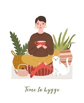 Illustratie van schattige jonge vrouw het drinken van thee en kat met letters