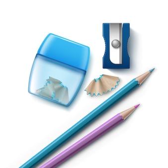 Illustratie van twee potloden en puntenslijpers verschillende vormen met krullen