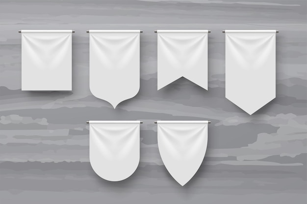 Illustratie van verschillende vormen witte wimpels met realistische schaduwen op grijs marmer