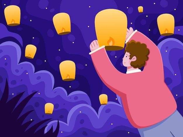 Indiaanse mensen laten lantaarns de lucht in en lanceren om het diwali-festival te vieren