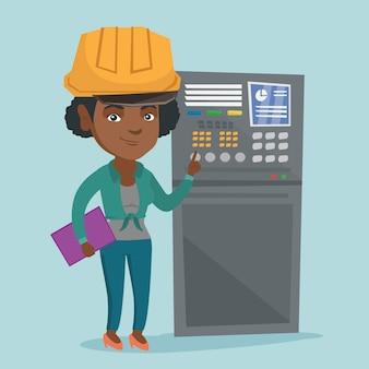 Industrieel ingenieur werkt aan het bedieningspaneel.