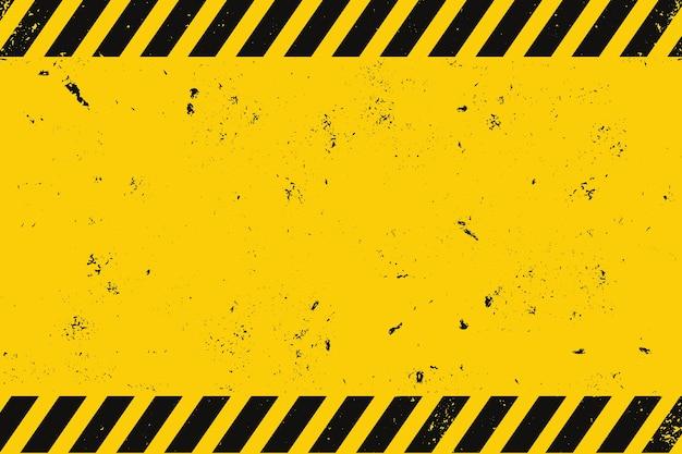 Industriële achtergrond met zwarte strepen op geel