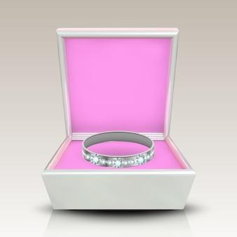 Ingelegde zilveren ring in witte vierkante doos
