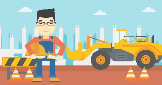 Ingenieur met bouwvakker en blauwdruk.