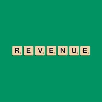 Inkomsten typografische letters in scrabbles blok alfabet concept