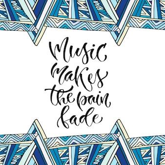 Inspirerende hand van letters voorzien citaat voor muuraffiche. muziek doet de pijn vervagen