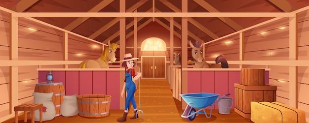 Interieur binnenkant stal met paarden en vrouw stalman
