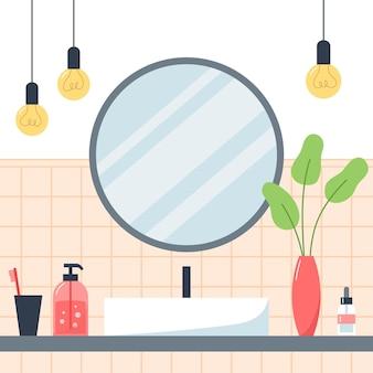 Interieur van badkamer met wastafel en ronde spiegel