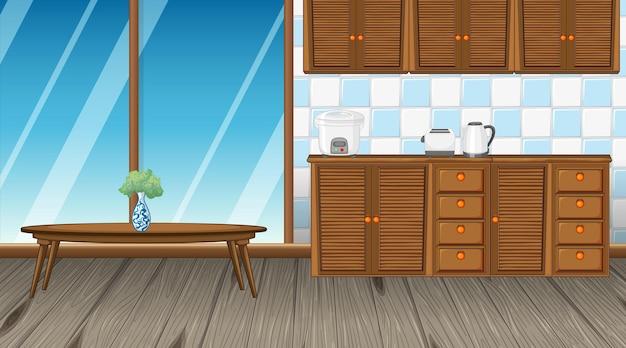 Interieur van de keukenkamer met aanrechtkast en tafel in het midden