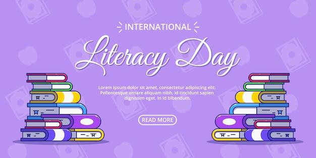 Internationale alfabetiseringsdagbanner met stapelboek.