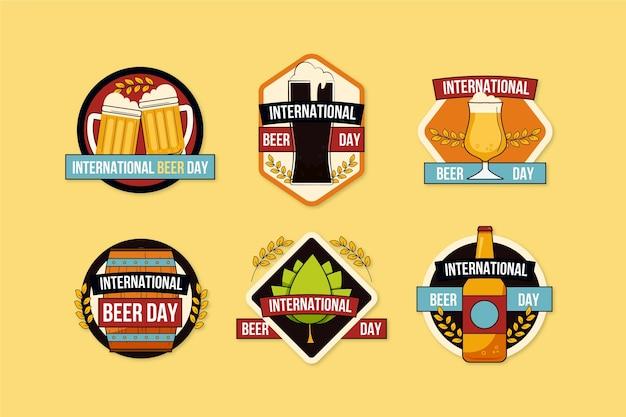 Internationale bierdaglabels in plat ontwerp