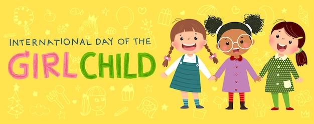 Internationale dag van de meisjeskindachtergrond met drie kleine meisjes die elkaars hand vasthouden