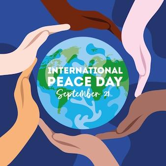 Internationale dag van de vrede belettering met interraciale handen rond de wereld