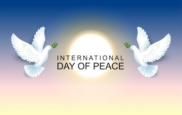Internationale dag van de vrede paar duiven houden een olijftak vast