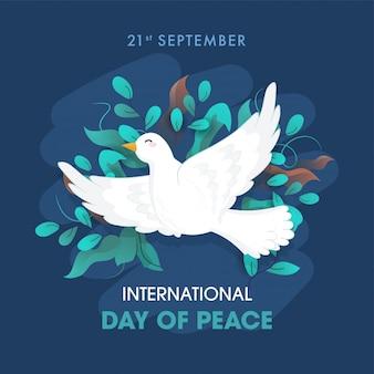 Internationale dag van de vrede tekst met vliegende duif en olijfbladeren versierd op blauwe achtergrond.