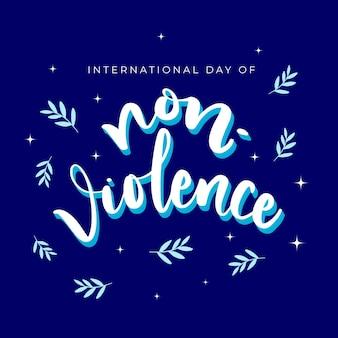 Internationale dag van geweldloosheid belettering met bladeren