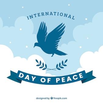 Internationale vrededag achtergrond met duif silhouet
