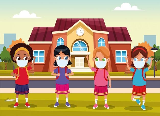 Interraciale meisjes die gezichtsmaskers gebruiken voor covid19 buitenhuis