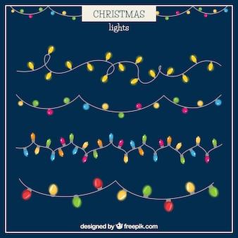Inzameling van gloeiende kerstmislichten